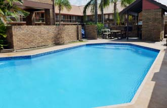 Relax by the Pool at Royal Palms Motor Inn - Coffs Harbour NSW.